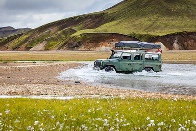 4WD car wades river