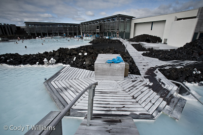 Blue Lagoon geothermal spa is one of the most visited attractions in Iceland, south of Reykjvik. The spa is located in a lava field in Grindavík, Iceland; not far from the Keflavík International Airport.  The lagoon is fed by the water output of a nearby geothermal power plant. Superheated water is vented from the ground near a lava flow and used to run turbines that generate electricity. September, 2009 © Cody T Williams.