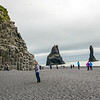 Reynisfjara, black sand beach waith stacked basalt rocks.