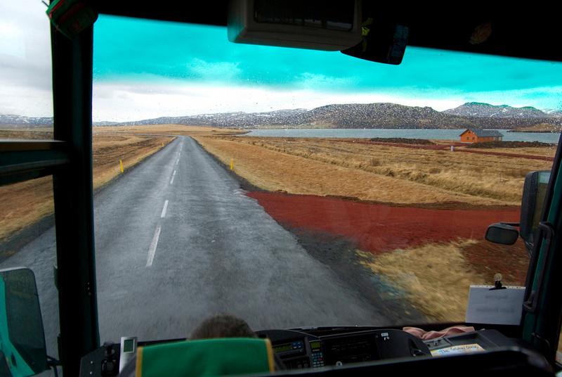 Long road, red gravel