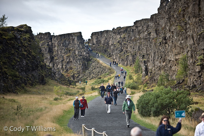 Visitors walk through Thingvellir National Park, a UNESCO's World Heritage site, where one can observe the the geological wonder of the mid-Atlantic ridge, the drifting apart of the continental plate of Europe and North America in Iceland. September, 2009 © Cody T Williams.