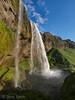 Seljalandsfoss - Can you spot my wife behind the fall?.<br /> 7 mm focal length