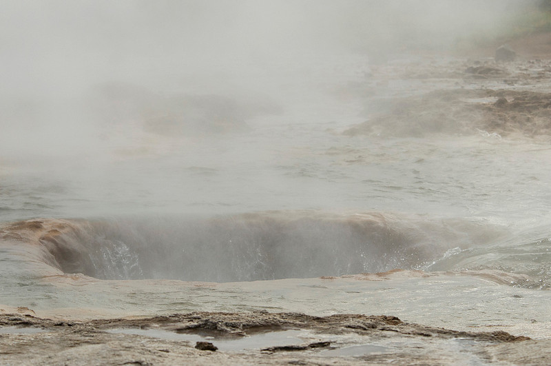 Strokkur erupting (fountain geyser) in the geothermal area beside the Hvítá River