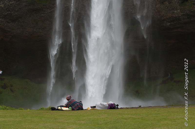 Relaxing in front of Seljalandsfoss