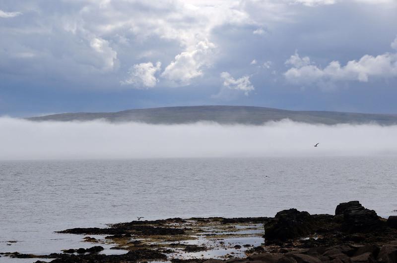 Grimsey Island shrouded in mist looking across the Greenland Sea from near Drangsnes.