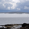 Grimsey Island shrouded in mist looking across the Greenland Sea from near Drangsnes.
