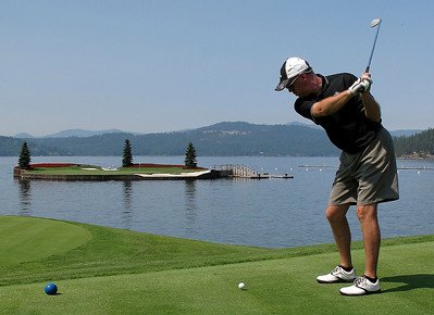 A golfer aims for the 14th green at The Coeur D'Alene Resort Golf Course. The floating island green can be moved, providing a changing challenge for returning golfers.