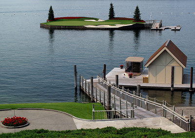 "The famous floating green at The Coeur D'Alene Resort Golf Course. Glofers hit their shots to the island, then board ""Putter,"" the boat in the foreground, for the ride to finish the hole."