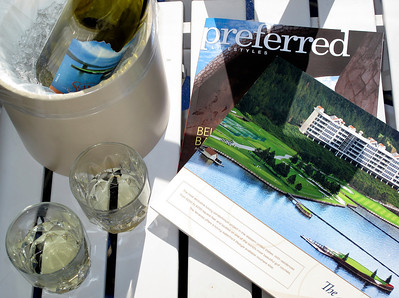 Glasses of chardonnay accompany magazines on the deck outside a room at the Coeur D'Alene Resort Hotel.