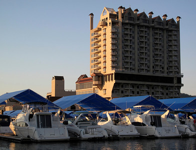 The Coeur D'Alene Resort hotel as seen from the boardwalk surrounding the nearby marina.