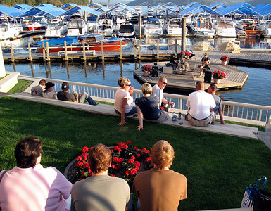 Patrons listen to a band playing on the floating stage near the marina of the Coeur D'Alene Resort hotel.