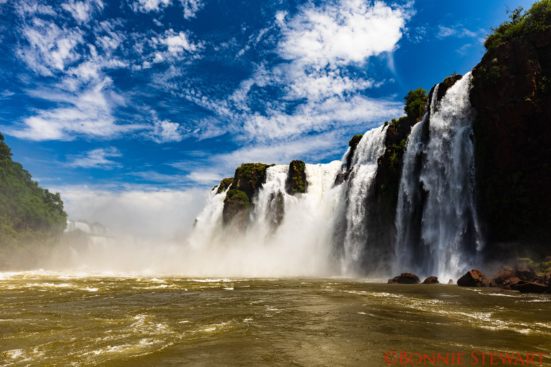 A few of Iquazu Falls from a boat giving a bottom to top view from the Brazil side