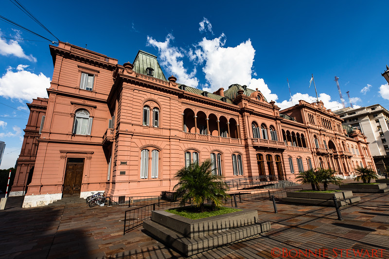 Presidential Palace in Argentina's Capital of Buenos Aires showing the balconies where Eva and Juan Peron would address the people.  The name in Spanish is Casa Rosa or Red House.