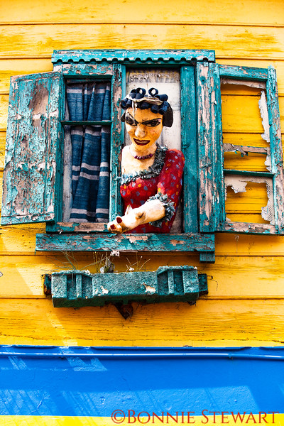 """La Boca neighborhood or Barrio in Buenos Aires known for colorful buildings and TANGO - the national dance of Argentina.  This sculpture is above the """"BAR"""" sign in the previous photo."""