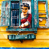 "La Boca neighborhood or Barrio in Buenos Aires known for colorful buildings and TANGO - the national dance of Argentina.  This sculpture is above the ""BAR"" sign in the previous photo."