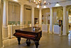 Grand piano and galleries in the old Hotel Alcazar ballroom, Lightner Museum, St. Augustine, Florida