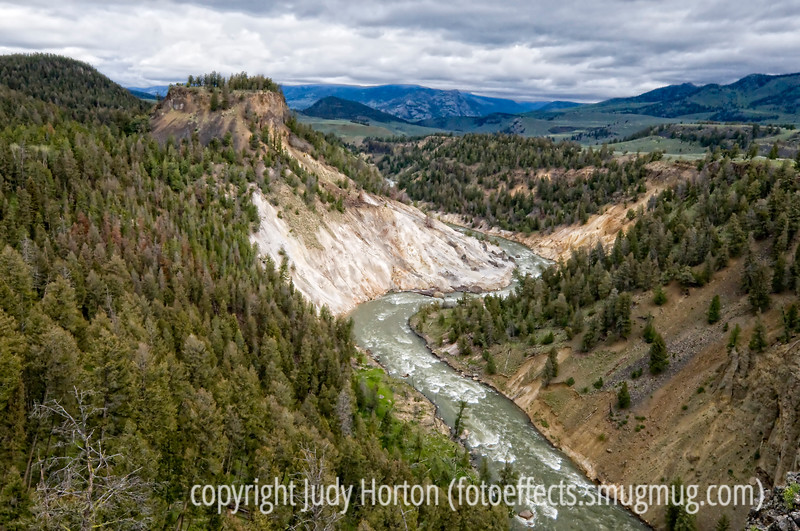 An expansive view of the Yellowstone River and the Lamar Valley of Yellowstone beyond.