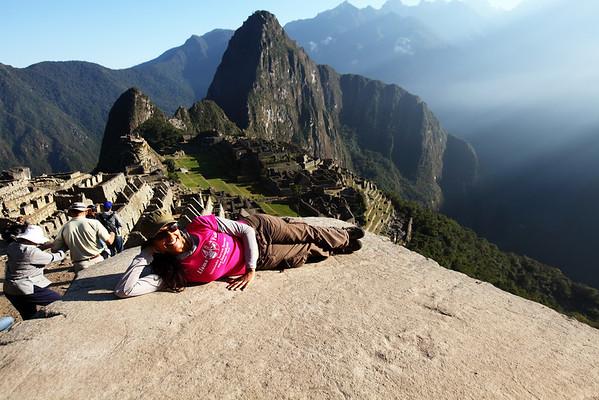 Priya relaxes at Machu Picchu.