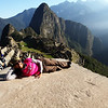 Priya relaxes at Machu Picchu.