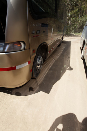 Our bus down to Aguas Calientes breaks down.  Tire almost comes off.  LOL