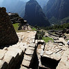 A view looking down into the ceremonial baths of Machu Picchu.  Look at the stone with the small channel cut out.