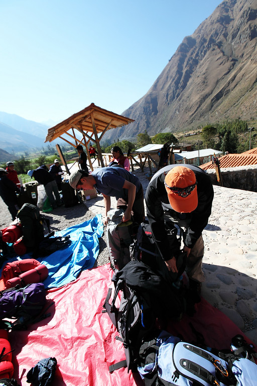 """As we existed the bus, the porters placed a tarp on the ground.  We were descended upon by locals trying to sell us water and walking sticks.  I told the same lady """"no gracias"""" about 10 times, as she kept offering me a walking stick, telling me it was """"essential"""".  After I organized my gear, I walked down to the right and paid 1 sole to take a crap in a real toilet.  Wouldn't see one of those for a while."""