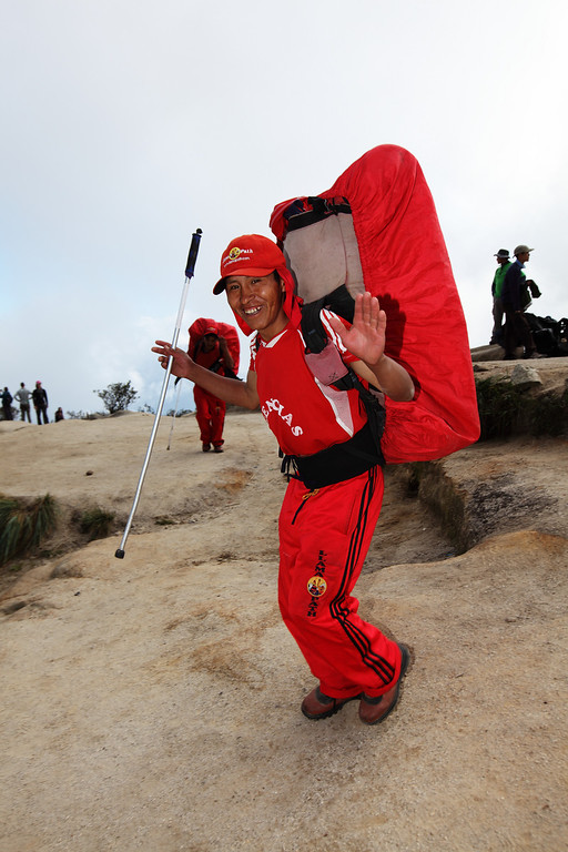 """""""no hands"""" - Porters race off as we finish taking our break.  Look how much they are carrying.  Amazing."""