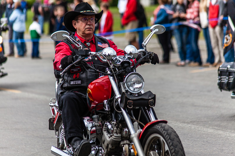 Man on motobike in fourth of July parade