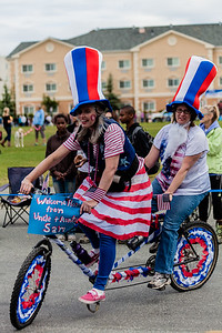 Girl on a bike in fourth of July parade