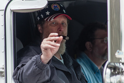 Man with cigar in fourth of July parade