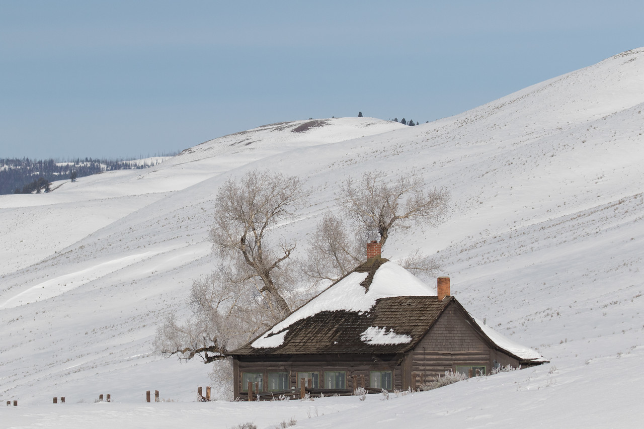 The Lamar Valley Ranger Station nicely tucked into the snowy mountain side.