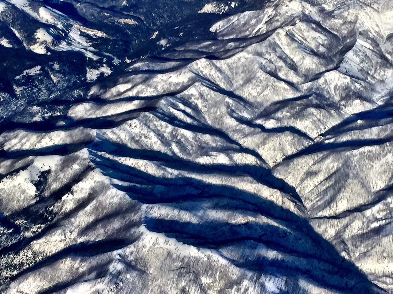 As we flew into Bozeman, we were glued to the windows viewing the patterns in the snow capped mountains.  The shadows emphasized the peaks and valleys and presented us with a dramatic welcome to Montana  and YNP.