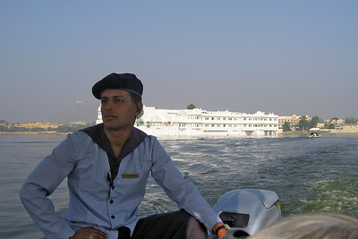 On the boat and the Lake Palace Hotel in the distance