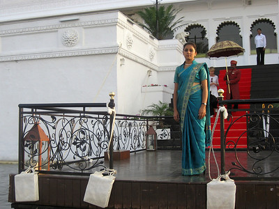 Lake Palace Hotel staff welcoming our boat