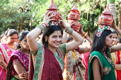 Carrying water vessels during the Vidhi.