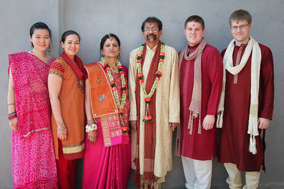 Us in our Indian clothes posing with the parents of the groom.