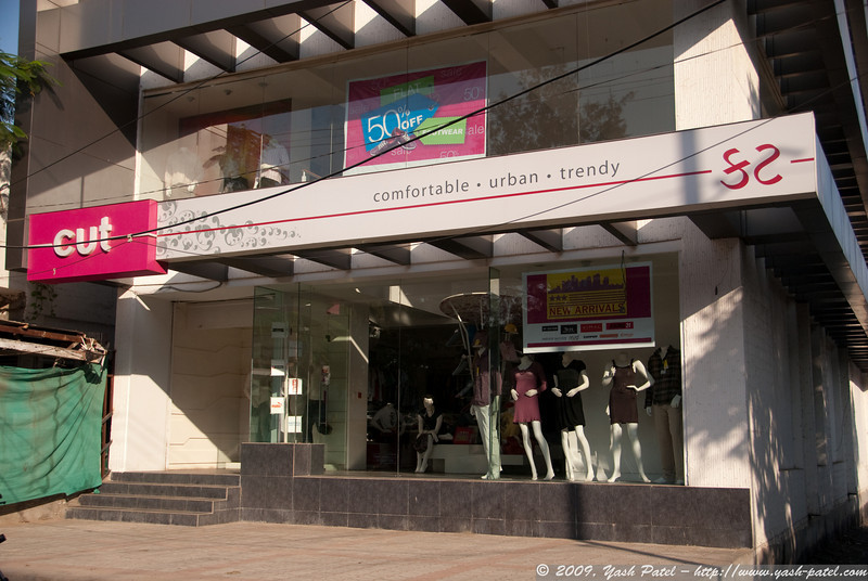 """Standing in contrast to typical Indian retail outlets, these modern storefronts are becoming more prevalent as time passes. """"comfortable. urban. trendy"""""""