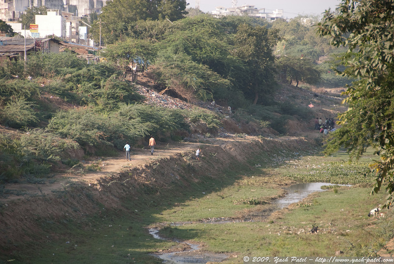 This is a river bed - the river dried up long ago. Now people hang out there and fly kites.