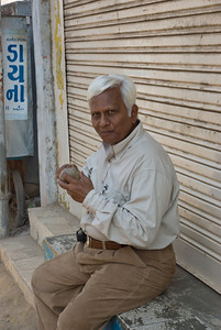 Dilipmama enjoying his kohta (wood apple)