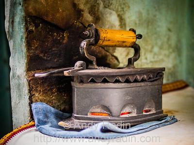 Coal-heated clothes iron, Varanasi, India