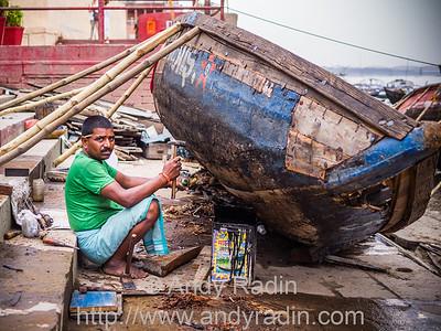 Boat repairs along the Ganges. Varanasi, India