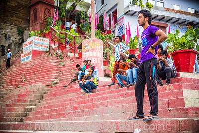 Cricket outfielder on this stepped ghat, where cricket is played every day. Varanasi, India