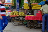 Fruit stand by road in New Delhi, India. 2015