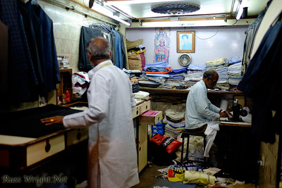 Tailors work in small shop off an alley in Old Delhi, India. 2015