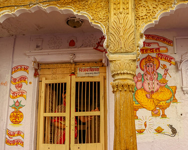 A Ganesh is painted at the entrance of a Hindu home, with the date the couple got married.