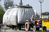 Grain being transported by tractor.