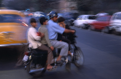 Dad with kids on motorcycle, Kolkata.