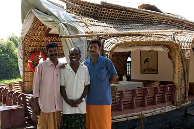 The crew in front on their houseboat, Kerala backwaters.