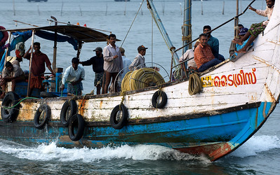Fishing boat returning after day on sea, Cochin, Kerala.