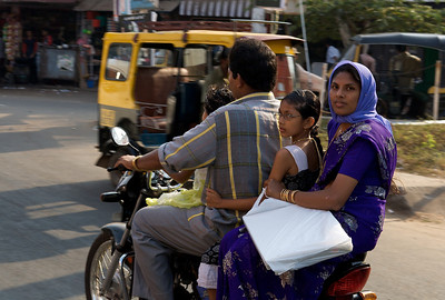 The entire family on a motorcycle, Cochin, Kerala.